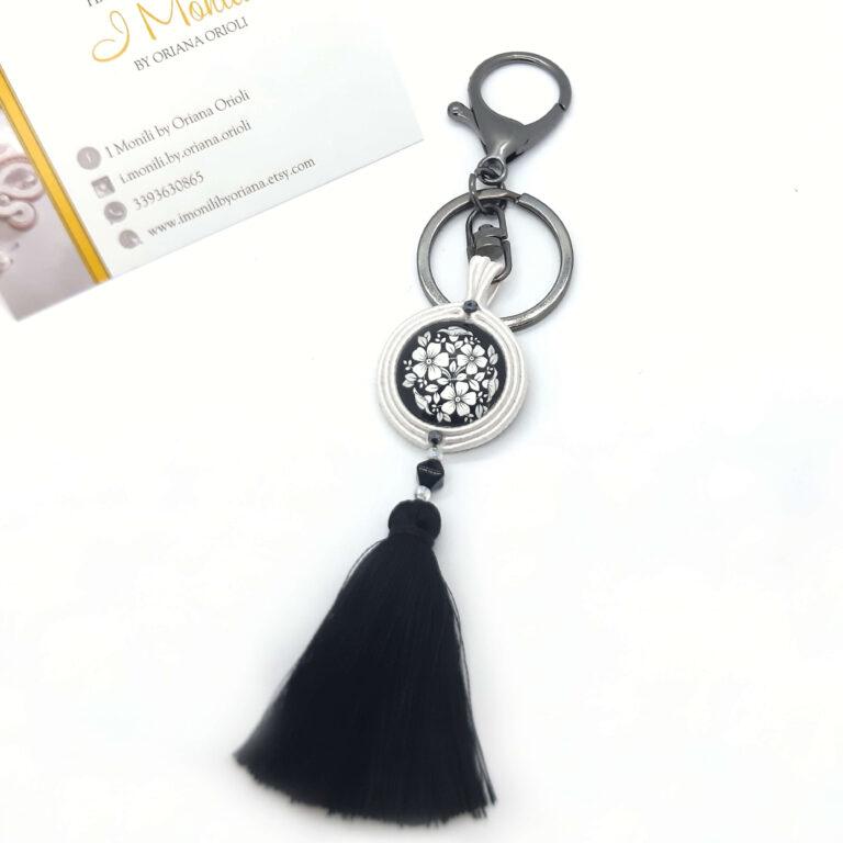 ciondolo da borsa pendente bianco e nero